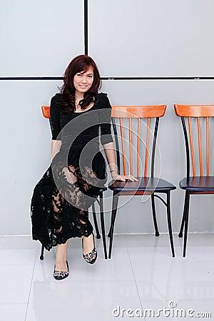 Beautiful asian woman sitting