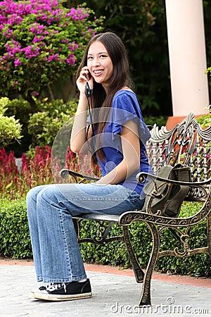 Beautiful asian woman using handphone