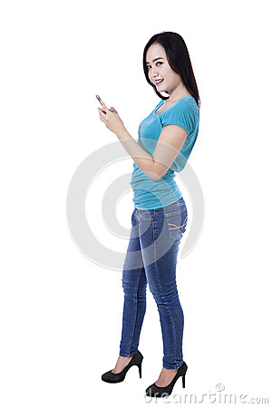 Beautiful asian woman using a mobile phone