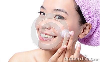 Beautiful asian woman washing her beauty face