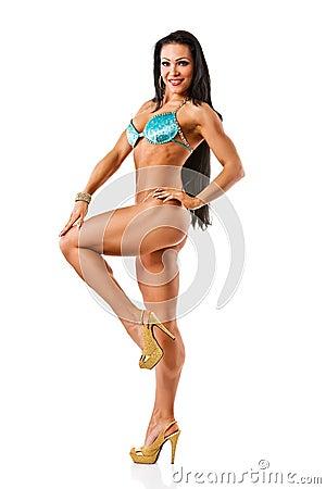 Beautiful athletic girl wearing bikini posing over white backgro