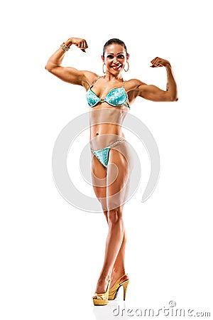Beautiful athletic girl wearing bikini posing over white