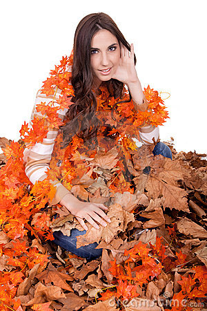Beautiful autumn girl covered with  leaves