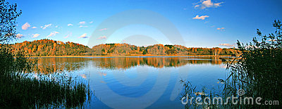 Beautiful autumn panoramic landscape of lake