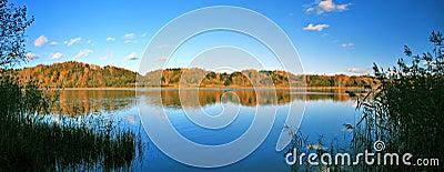 Beautiful autumn panoramic landscape of lake
