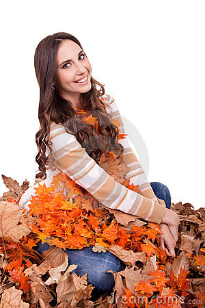 Beautiful autumn woman covered with  leaves