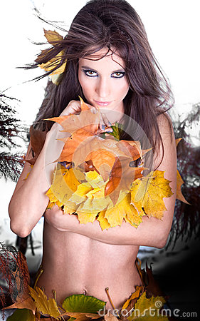 Beautiful Autumn woman with leaf