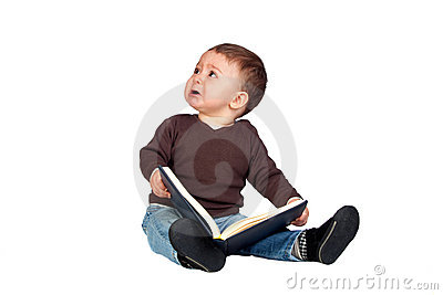 Beautiful baby with a book crying