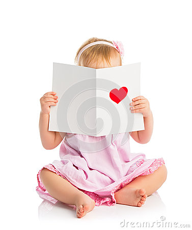 Beautiful baby girl with cute valentine postcard with a red hear Stock Photo