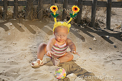 Beautiful Baby Girl Playing on the Beach