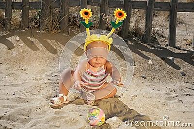 Beautiful Baby Girl Playing on the Beach