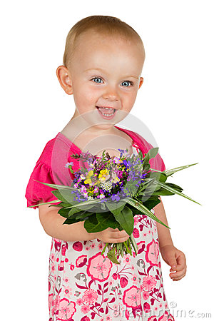 Beautiful baby girl with a posy of flowers