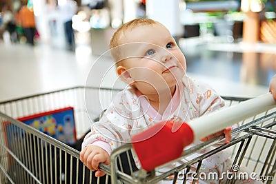 Beautiful baby girl in shopping cart - trolley