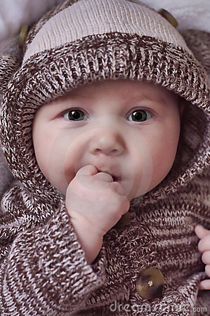Beautiful Baby with Hands in Mouth