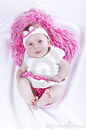 Beautiful baby with heart pink pillow