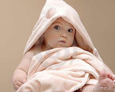 Beautiful baby in a pink blanket