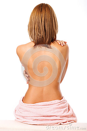 Beautiful back of a young woman after shower isolated on white b