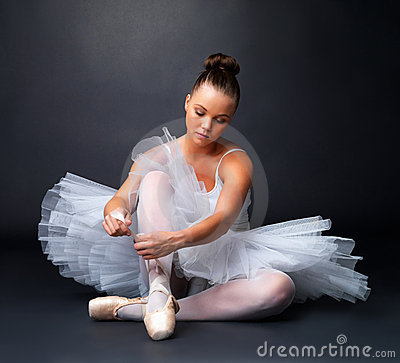 Beautiful ballerina puts on Pointe