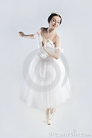 Beautiful ballerina in a white dress