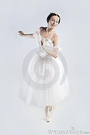 Beautiful ballerina in a white dress