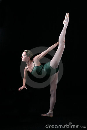 Beautiful Ballet Dancer with one leg in air