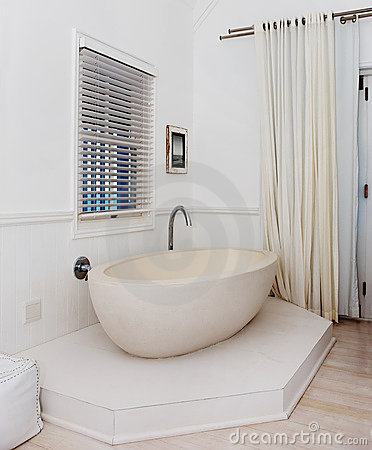 Beautiful bathtub in the corner of a room