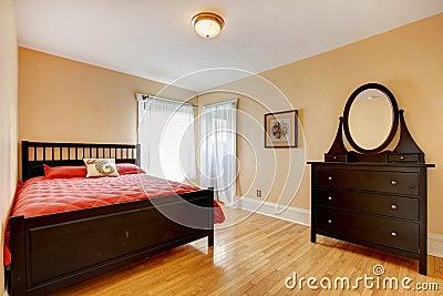 Beautiful bedroom with dark brown furniture