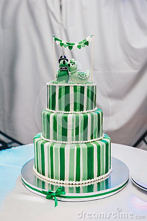 Free Beautiful Big Three Leveled Wedding Cake Decorated With Two Birds On The Top. A Green-white Striped Wedding Cake With Stock Photography - 97693792