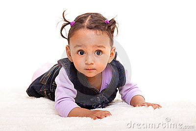Beautiful biracial baby girl lying on the floor