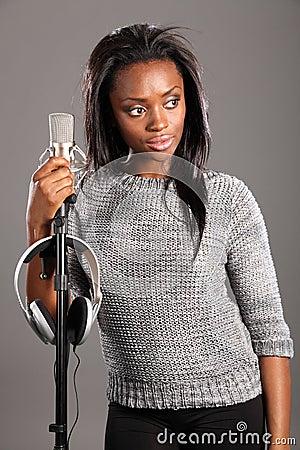 Beautiful black girl singer in studio relaxing