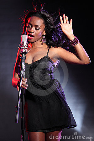 Free Beautiful Black Singer On Stage With Microphone Stock Photos - 19184893