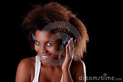 Beautiful black woman happy listening music