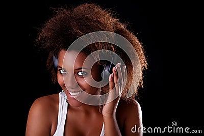 Beautiful black woman happy listening music