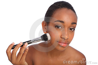 Beautiful black woman using make up powder brush