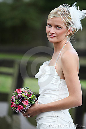 Beautiful blond bride holding bouquet