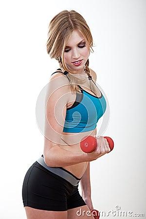 Beautiful blond caucasian woman exercising