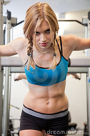 Beautiful blond caucasian woman exercising