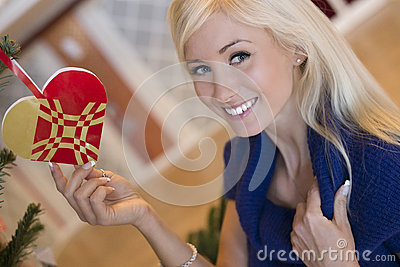 Beautiful blond girl with christmas ornament