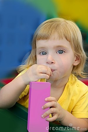 Beautiful blond girl drinking pink juice