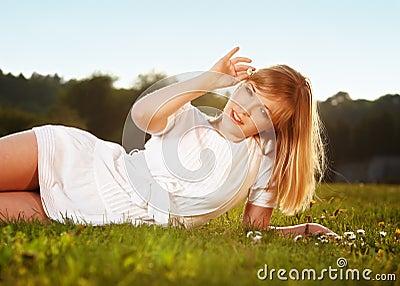Beautiful blond girl on a grass