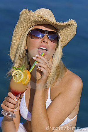 Free Beautiful Blond Girl In Bikini Drinking Cocktail Stock Photography - 12743762