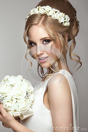 Free Beautiful Blond Girl In Image Of The Bride With White Flowers On Her Head. Beauty Face. Stock Images - 99947264