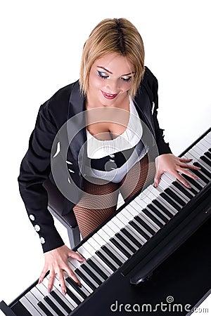 Beautiful blond girl playing piano