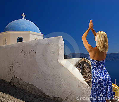 Beautiful blond girl praying