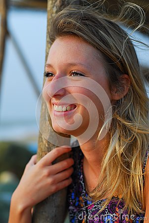 Beautiful blond girl smiling on beach