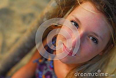 Beautiful blond girl smiling at camera