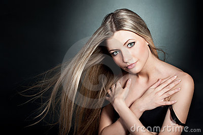 Beautiful blond girl wearing in black bra with blo