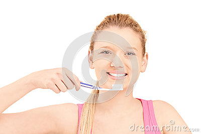 A beautiful blond woman brushing her teeth
