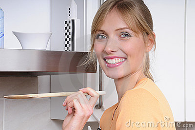 Beautiful blond woman cooking a tasty meal