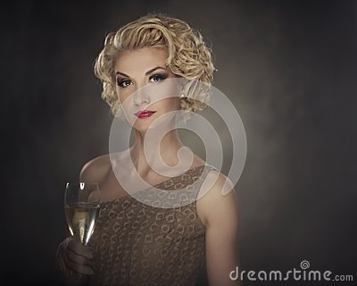 Beautiful blond woman with a drink